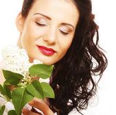 Mulher com flores brancas — Fotografia Stock