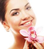 Mujer joven con rosa orquídea — Foto de Stock