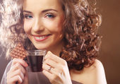 Attractive woman with coffee and cookies — Stock Photo