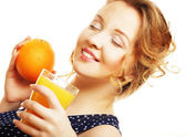 Woman holding orange and juice over white — Stock Photo