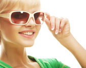 Woman wearing sunglasses over a white background — Стоковое фото