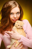Woman with red England lop-eared kitten — Stock Photo