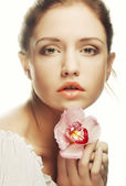 Beautiful woman with pink flower — Stock Photo