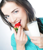 Woman with milk and strawberry — Stock Photo
