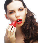 Sexy lady holding a juicy strawberry — Stock Photo