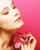 Woman with orchid flower — Stock Photo