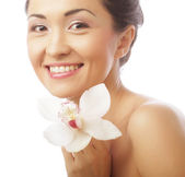 Beautiful woman face with  orchid flower — Stock Photo