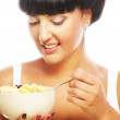 Smiling woman eating muesli — Stock Photo #44522803
