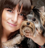 Young girl with her Yorkie puppy — Стоковое фото
