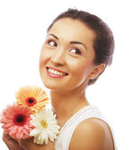 Young asian woman with bouquet flowers — Stock Photo