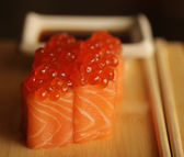 Rolls with salmon and red caviar — Stock Photo