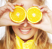 Portrait on young and healthy woman with orange — Stock Photo