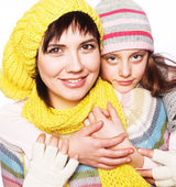 Beautiful mother daughter winter portrait — Stockfoto