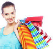 Young woman carrying shopping bags — Stock Photo