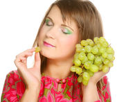 Woman with bunch of grape. — Stock Photo