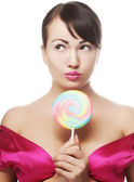 Pretty woman with lollipop — Stock Photo