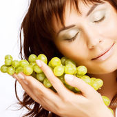 Young woman with green grapes — Stock Photo