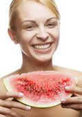 Mujer joven con melón de agua — Foto de Stock