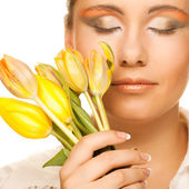 Woman with yellow tulips  over white — Stock Photo