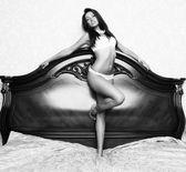 Sexy glamour woman in white bikini on the bed — Stock Photo