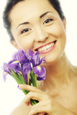 Young asian model with iris flowers. — ストック写真