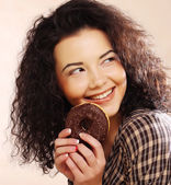 Woman holding a donut — Stock Photo