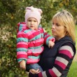 Happy mum with a daughter in autumn park — Stock Photo #47865861