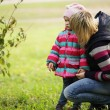 Happy mum with a daughter in autumn park — Stock Photo #47865873
