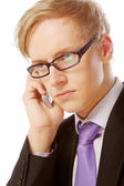 Young man with glasses use mobile — Stock Photo