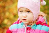 Kid in autumn park — Stock Photo