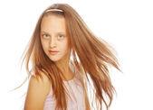 微笑在工作室在白色背景上的小女孩 — 图库照片