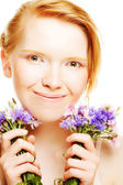 young beautiful woman with flowers — Stockfoto