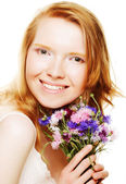 Young beautiful woman with flowers — Стоковое фото