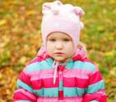 Happy kid in autumn park — Stock Photo