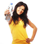 Confident gym woman with water bottle smiling — Stock Photo