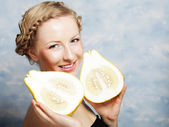 Girl holds in really big citrus fruit - pamelo, — Stock Photo