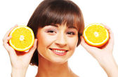 Young cheerful woman with oranges — Stockfoto