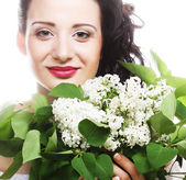 Woman with white flowers — Stock Photo