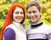 Two pretty girls  in autumn park — Foto de Stock