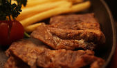 Rustic beefsteak with french fries — Stockfoto