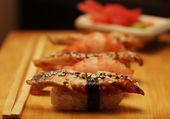 Japanese sushi on wood plate — Stock Photo
