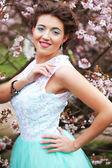 Beautiful young woman at spring garden — Stock Photo