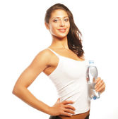 Smiling young sporty woman with water — Stock Photo