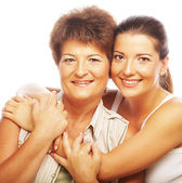 Daughter embracing her mother — Stock Photo