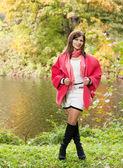Woman  near the river in autumn season — Stock Photo