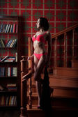 Sensual woman  wearing lingerie posing on stair — Stock Photo