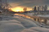 Sunrise over frosty river — Stock Photo