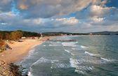 Sea, beach and clods — Stock Photo