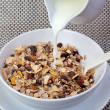 Muesli breakfast in package.Bottle milk and spoon — Stok fotoğraf