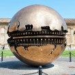 VATICAN - AUGUST 22: Sphere within sphere in Courtyard of the Pinecone at Vatican Museums at Augustr 22, 2013. Sphere was created in 1990 by Italian sculptor Arnoldo Pomodoro. — Stock Photo